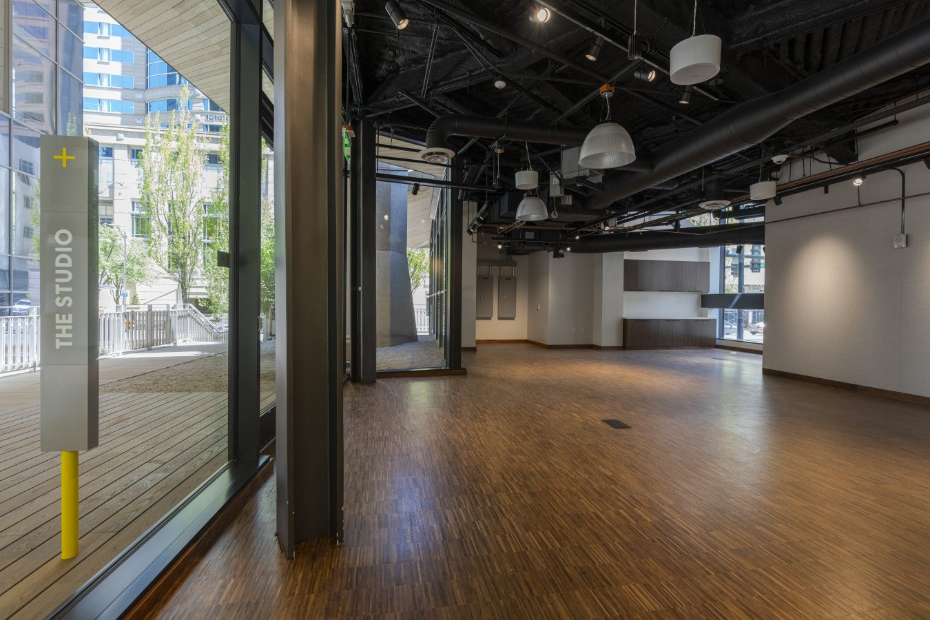 The Studio is 1100 square feet, has hardwood floors, a single restroom, and Blue-tooth enabled sound system